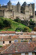 The fortified citadel of Carcassonne viewed over the terracotta rooftops of the lower town