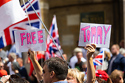 """A woman's hands hold up """"Free Tommy"""" placards as several hundred protesters in London in central London demand the release of """"political prisoner"""" right wing talisman Stephen Yaxley-Lennon  - also known as Tommy Robinson, who was imprisoned for contempt of court. London, August 03 2019."""