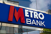 Sign for Metro Bank on 18th May 2021 in Birmingham, United Kingdom. Metro Bank will be introducing Customers to unparalleled levels of service and convenience. This unique retail banking model, created by Metro Banks founder Vernon W. Hill, revolutionised banking in the United States.