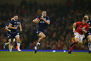 Stuart McInally of Scotland makes a break. Wales v Scotland, NatWest 6 nations 2018 championship match at the Principality Stadium in Cardiff , South Wales on Saturday 3rd February 2018.<br /> pic by Andrew Orchard, Andrew Orchard sports photography