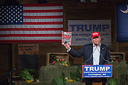 Billionaire and GOP presidential candidate Donald Trump holds up Time Magazine as he addresses supporters at a rally January 27, 2016 in Lexington, South Carolina.