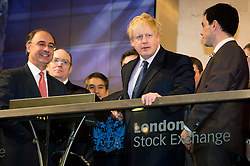 © London News Pictures. 12/02/2013 . London, UK. Mayor Of London, BORIS JOHNSON (centre) opening the days trading at the London Stock Exchange with XAVIER ROLET, CEO of London Stock Exchange Group (left ).  Photo credit : Ben Cawthra/LNP