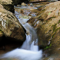 Landscape image of a small cascade at the bottom of the top portion of Dark Hollow Falls, Shenandoah National Park, Virginia.