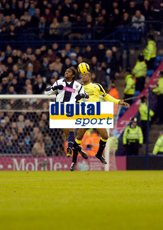 Photo: Leigh Quinnell.<br /> West Bromwich Albion v Manchester City. The Barclays Premiership. 10/12/2005.West Broms Nwankwo Kanu rises with Man Citys  Sylvain Distin.