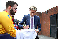 Steve Parish, the Crystal Palace chairman/ co-owner signs his autograph for fans arriving at Selhurst Park. Premier League match, Crystal Palace v Stoke city at Selhurst Park in London on Sunday 18th Sept 2016. pic by John Patrick Fletcher, Andrew Orchard sports photography.