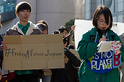 """Aina Koide (right) talks to young  people taking part in the Global Strike for Future at the United Nations University, Shibuya, Tokyo, Japan.Friday March 15th 2019. Part of a global day of action in 98 countries and nearly 2,000 cities; this was Japan's second Fridays for Future event, known as """"School strikes"""", and took place from 2pm to 4pm with activists and students holding signs demanding leaders, internationally and nationally, take measures to reduce ecologically damaging activities. The movement was started in 2018 by Swedish schoolgirl, Greta Thunberg, who began striking from her lessons when she realised that adult leaders were doing nothing to ensure there would be the future she was studying for."""