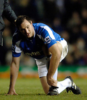 Photo: Glyn Thomas.<br />Birmingham City v Torquay United. The FA Cup. 17/01/2006.<br />Birmingham's Martin Taylor leaves the field with an ankle injury.