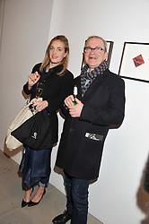 POLLY MORGAN and HARRY ENFIELD at a private view of work by Mat Collishaw - 'This is Not an Exit' held at Blaine/Southern, 4 Hanover Square, London on 13th February 2013.