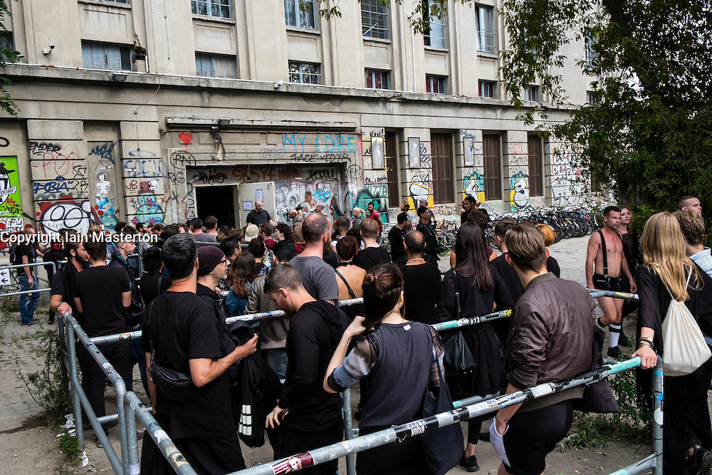 Clubbers queuing outside infamous Berghain nightclub on a Sunday afternoon in Berlin Germany - Editorial Use Only Editorial Use Only.