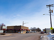 """25 FEBRUARY 2020 - BUTTERFIELD, MINNESOTA: Downtown Butterfield, MN, a farming community of about 500 people 130 miles southwest of the Twin Cities. The town has been a """"food desert"""" for 10 years after its only grocery store closed in 2010. Barb Mathistad Warner and Mark Warner purchased the True Value store in Butterfield in December, 2018 and started selling groceries in the store in May, 2019. For residents of Butterfield going to a grocery store meant driving 10 miles to St. James, MN, or 20 miles to Windom, MN, the two nearest communities with grocery stores. The USDA defines rural food deserts as having at least 500 people in a census tract living 10 miles from a large grocery store or supermarket. There is a convenience store in Butterfield, but it sells mostly heavily processed, unhealthy snack foods that are high in fat, sugar, and salt.    PHOTO BY JACK KURTZ"""