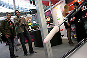 An exhibitor is showing one of his sex machines to a visitor at the Erotica 2006 show in London, UK, on Friday, Nov. 17, 2006. Erotica is the world's largest adult lifestyle show. It attracts about 80,000 visitors every year with its over 150 retailer exhibitors, dazzling and decadent transvestite cabaret shows, fun foreplay seminars, beautiful lingerie collections, art and fetish demonstrations. **Italy Out**