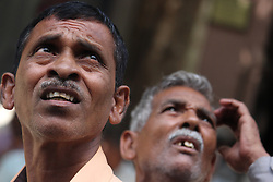 May 23, 2019 - Mumbai, India - Men look at a display of stock prices outside the Bombay Stock Exchange (BSE) building in Mumbai, India on 23 May 2019. The weeks-long general election show a clear victory for BJP and, its NDA (National Democratic Alliance) coalition, which has won more than 300 of a total of 543 seats in parliament. The happiness is being witnessed in benchmark Sensex as it passed the 40,000 mark as per media report. (Credit Image: © Himanshu Bhatt/NurPhoto via ZUMA Press)