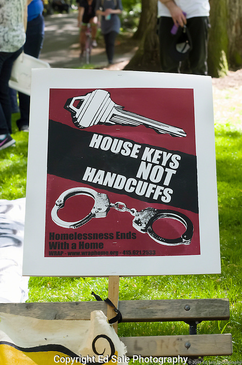 Protest sign House Keys Not Handcuffs supports homeless people in Portland, Oregon looking for permanent housing solutions. Sign par of 2015 May Day Rally.