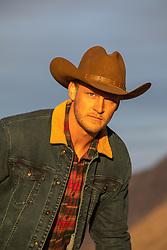 portrait of a cowboy at sunset