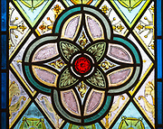 Nineteenth century decorative stained glass window with floral geometric pattern, Easton Royal, Wiltshire, England, UK