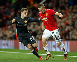 CSKA Moscow's Fedor Chalov (left) and Manchester United's Luke Shaw in action during the UEFA Champions League match at Old Trafford, Manchester.