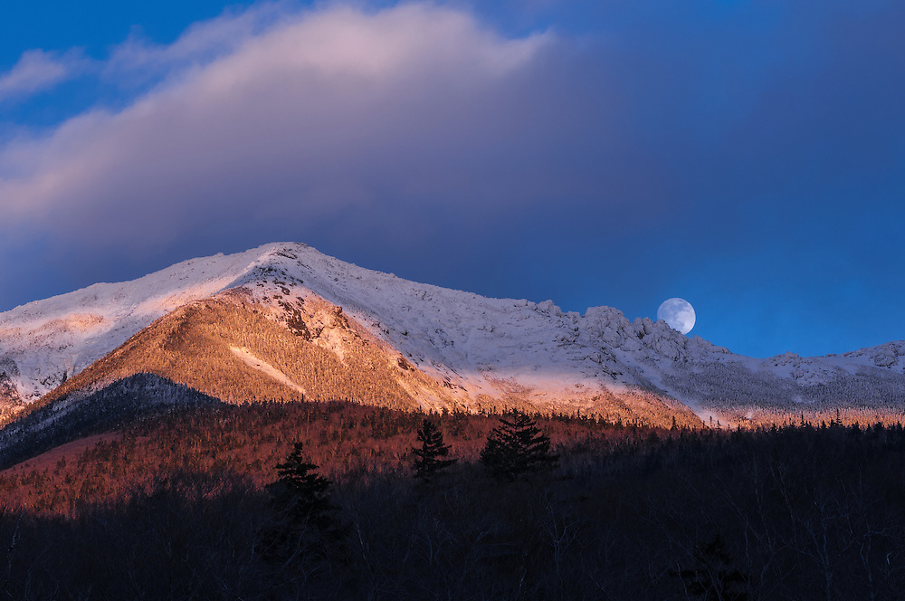 Full moon rise over snowy mountain peaks, Mt Lincoln, Franconia Notch State Park, Franconia, NH