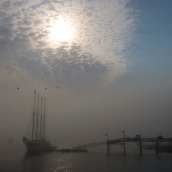 Fog in Bar Harbor obscures the view of The Margaret Todd, a four-masted schooner.  Morning.  Maine.