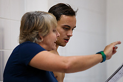 Tom Daley of Dive London Aquatic Centre is instructed by coach Jane Figueiredo during the Mens 10m Platform Preliminary - Photo mandatory by-line: Rogan Thomson/JMP - 07966 386802 - 22/02/2015 - SPORT - DIVING - Plymouth Life Centre, England - Day 3 - British Gas Diving Championships 2015.