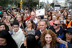 People gather to see the Duke and Duchess of Sussex in Melbourne, on the third day of the royal couple's visit to Australia.