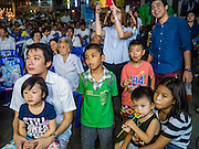 15 OCTOBER 2015 - BANGKOK, THAILAND:  People watch a Chinese opera performance during the Vegetarian Festival at the Joe Sue Kung Shrine in the Talat Noi neighborhood of Bangkok. The Vegetarian Festival is celebrated throughout Thailand. It is the Thai version of the The Nine Emperor Gods Festival, a nine-day Taoist celebration beginning on the eve of 9th lunar month of the Chinese calendar. During a period of nine days, those who are participating in the festival dress all in white and abstain from eating meat, poultry, seafood, and dairy products. Vendors and proprietors of restaurants indicate that vegetarian food is for sale by putting a yellow flag out with Thai characters for meatless written on it in red. The shrine is famous for the Chinese opera it hosts during the Vegetarian Festival. The operas are free.   PHOTO BY JACK KURTZ