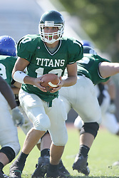15 September 2007:  Kraig Ladd looks to hand off to a back. . The Titans stood toe to toe with the 25th ranked Lions through the first half but ended the game on the losing end of a 25-15 score at Wilder Field on the campus of Illinois Wesleyan University in Bloomington Illinois.