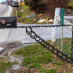 Bart, PA, USA - March 3, 2018: Repurposed horse shoes used to make a rural mailbox post in Lancaster County, Pennsylvania.