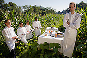 Chef Dan Barber with one day's worth of food on a sunny summer day in downstate New York, outside New York City. (Dan Barber is featured in the book What I Eat; Around the World in 80 Diets.) Members of his kitchen staff, and farm staff from the Stone Barns Center for Food & Agriculture hold the equivalent of a day's worth of tastings that he does spoon by spoon in the restaurant kitchen during the day's food preparation. He is executive chef of the restaurant Blue Hill at Stone Barns, in Pocantico Hills, New York,  and the Blue Hill Restaurant in New York City.