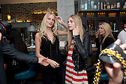 POPPY DELEVIGNE; CARA DELEVIGNE, Willow launch.  The Riding House Cafe, Great Titchfield St. London. 22 June 2011. <br /> <br />  , -DO NOT ARCHIVE-© Copyright Photograph by Dafydd Jones. 248 Clapham Rd. London SW9 0PZ. Tel 0207 820 0771. www.dafjones.com.