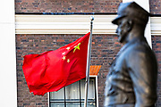 "People's Republic of China flag is seen waving opposite a World War II statue by the Chinese Embassy in London on Monday, July 20, 2020 - as the U.K., tensions with China are rising. United Kingdom suspended the extradition treaty with Hong Kong ""immediately and indefinitely"" as well as existing embargo arms against China is extended to Hong Kong U.K. Foreign Secretary Dominic Raab announced on Monday afternoon through a statement in the British Parliament. (VXP Photo/ Vudi Xhymshiti)"