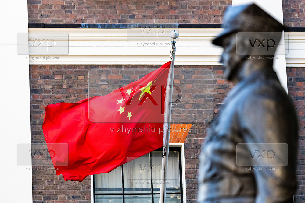 """People's Republic of China flag is seen waving opposite a World War II statue by the Chinese Embassy in London on Monday, July 20, 2020 - as the U.K., tensions with China are rising. United Kingdom suspended the extradition treaty with Hong Kong """"immediately and indefinitely"""" as well as existing embargo arms against China is extended to Hong Kong U.K. Foreign Secretary Dominic Raab announced on Monday afternoon through a statement in the British Parliament. (VXP Photo/ Vudi Xhymshiti)"""