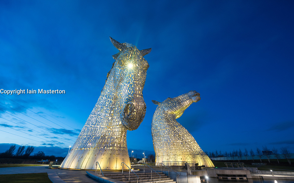 Night view of The Kelpies sculptures ( Scottish word for horses) at Helix Park in Falkirk , Scotland, United Kingdom