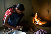 Pooja, 14, a student from the village of Pathpuri, Hoshangabad, Madhya Pradesh, India, taking part to the children's journal, a project launched by Dalit Sangh, an NGO which has been working for the uplift of scheduled castes for the past 22 years, is making Chapatti, a typical Indian bread in her home. Dalit Sangh is working in collaboration with Unicef India to promote education and awareness within backward communities.