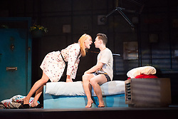 © Licensed to London News Pictures. 16/04/2013. Celebrating its twentieth anniversary year, and returning to the West End for limited 6 week season, the award winning Beautiful Thing comes to the Arts Theatre, London Featuring Suranne Jones, Zaraah Abrahams, Oliver Farnworth, Jake Davis and Danny-Boy Hatchard. Suranne Jones (Sandra) & Jake Davies (Jamie). Photo credit: Tony Nandi/LNP