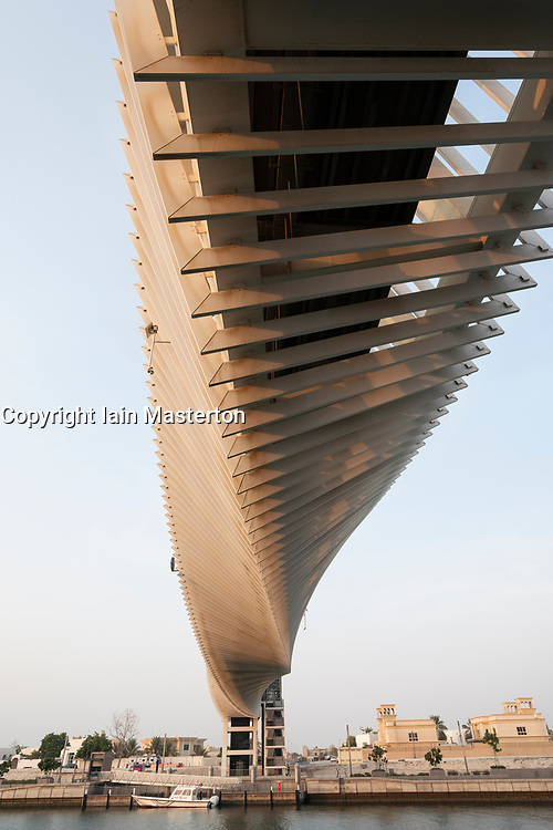 View of footbridge crossing new Dubai Water Canal a waterway that connects into Dubai Creek and the sea. UAE, United Arab Emirates