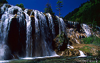 Nourilang waterfall in the beautiful world heritage and world biosphere reserve of Jiuzhaigou, Sichuan province, China.