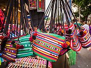 """07 APRIL 2013 - CHIANG MAI, CHIANG MAI, THAILAND:  Handbags for sale during the Chiang Mai """"Walking Street Market."""" The Walking Street Market starts at Thapae Gate and runs along the length of Ratchadamnoen Road through the heart of the Old City and has become a Chiang Mai institution. Chiang Mai is the largest town in northern Thailand and is popular with tourists and backpackers.       PHOTO BY JACK KURTZ"""