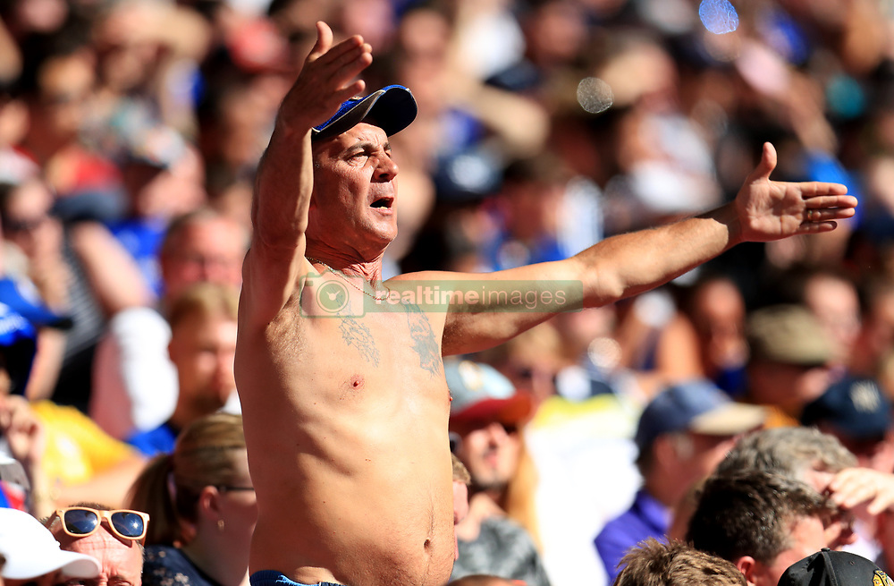 A Chelsea fan in the stands during the Community Shield match at Wembley Stadium, London.