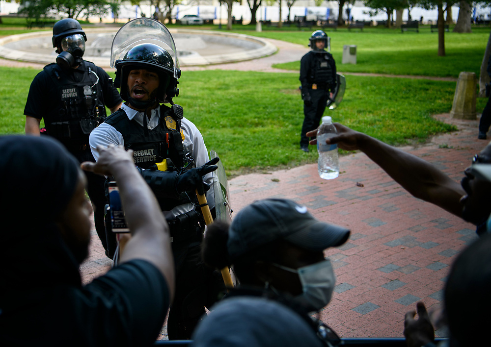 A secrete Service Police Officer speaks to protestors. Protests continue on Sunday at Washington DC's Lafayette Park, in response to the murder of George Floyd in Minneapolis. Various police agencies kept the protesters in the park, preventing them from getting close to the White House.
