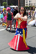 Brooklyn, NY - 18 June 2016. A woman costumesd as Wonder Woman with a mermaid's tail in the parade.