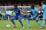 AFC Wimbledon midfielder Tom Soares (19) dribbling during the EFL Sky Bet League 1 match between AFC Wimbledon and Coventry City at the Cherry Red Records Stadium, Kingston, England on 11 August 2018.