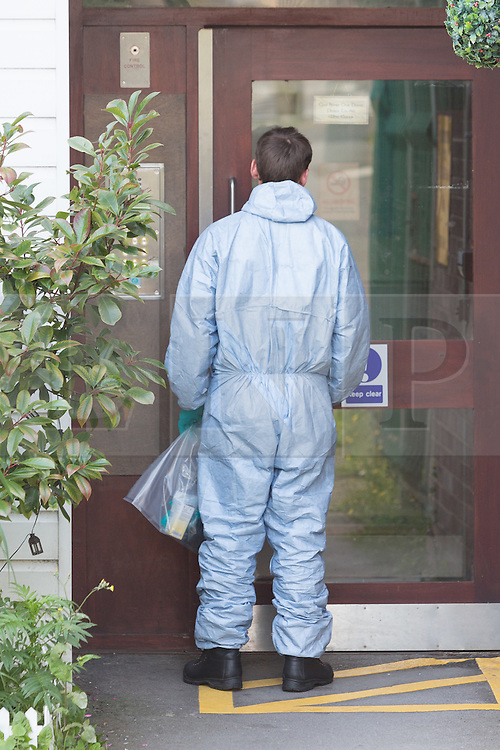 © Licensed to London News Pictures. 06/09/2015. London, UK. A forensic officer enters Fernways sheltered housing unit in Fernways off Cecil Road in Ilford, Essex. Police attended the unit last night following reports of an assault. A woman aged in her mid-50's and a man in his mid-80's were pronounced dead at the scene last night, who suffered stabbing injuries. Photo credit : Vickie Flores/LNP