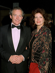 MR SIMON JENKINS and his wife actress GAYLE HUNNICUTT, at a dinner in London on 22nd May 1997.LYP 20