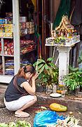 Laos. Luang Prabang. Morning market. Spirit house.