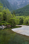 Gold Creek at a low water level flows past a rocky beach at Golden Ears Provincial Park in Maple Ridge, British Columbia, Canada