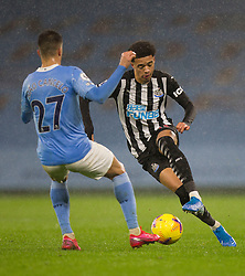 Jamal Lewis of Newcastle United (R) and Joao Cancelo of Manchester City in action - Mandatory by-line: Jack Phillips/JMP - 26/12/2020 - FOOTBALL - Etihad Stadium - Manchester, England - Manchester City v Newcastle United - English Premier League