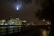 London's tallest skyscraper, the Shard, beams out spotlights as part of a light show creating a public art installation in the sky on 13th December 2016 in London, England, United Kingdom.