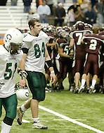 Cornwall's Brian McNally (84) and Mike Maggi walk off the field as Corning East players celebrate their 27-14 victory in the Class A state championship game at the Carrier Dome in Syracuse on Nov. 24, 2006.