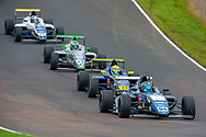 Sebastian Alvarez (MEX) of Double R Racing exits Butchers, closely followed by Zane Maloney (BAR) of Carlin Motorsport, Josh Skelton (GBR) of JHR Developments and Luke Browning (GBR) of Richardson Racing during Round 23 of the FIA Formula 4 British Championship at Knockhill Racing Circuit, Dunfermline, Scotland on 15 September 2019.