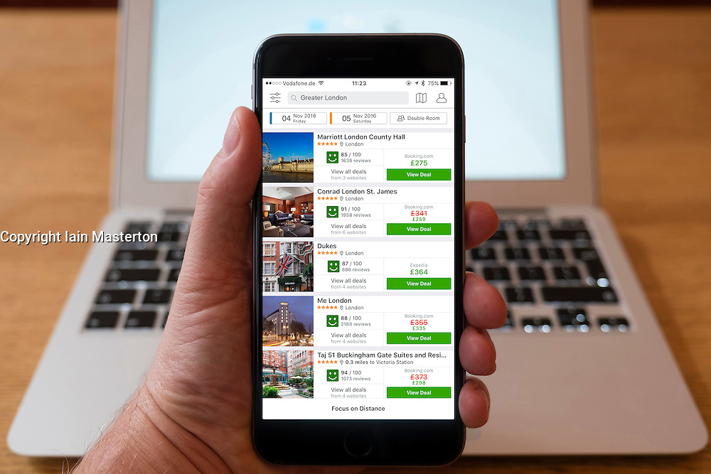 Using iPhone smartphone to display hotels listings in London on Trivago booking website